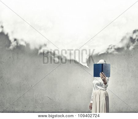 Woman with opened book against her face