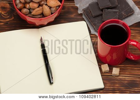 Blank Open Notepad. Cup Of Coffee. Wooden Background