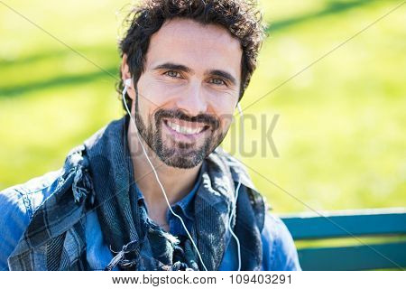 Portrait of a man listening music outdoors