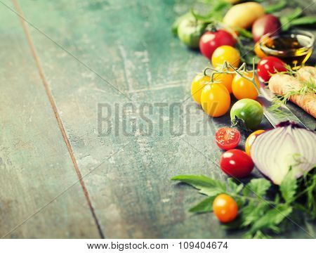 Vegetables on wood. Bio Healthy food, herbs and spices. Organic vegetables on wood. Cooking, Healthy Eating or Vegetarian concept.  Background layout with free text space.