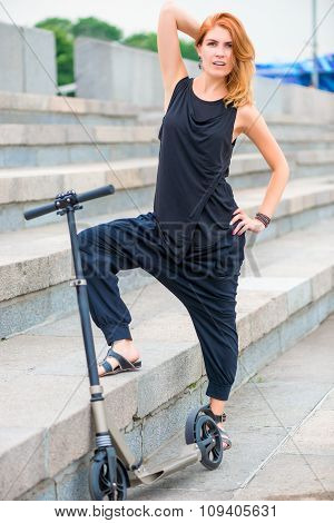 Woman With Scooter Posing On The Stairs