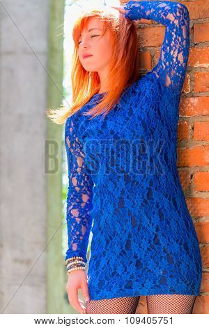 Female 30 Years, In A Lace Dress Posing Near The Wall