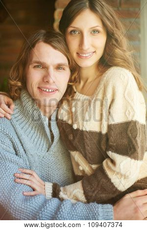Portrait of smiling young couple embracing