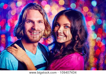 Happy young couple enjoying each other in nightclub