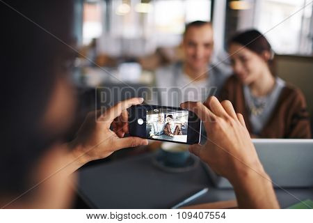 Young couple posing at camera in a caf�©