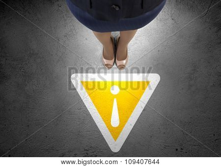 Top view of businesswoman feet and stop sign