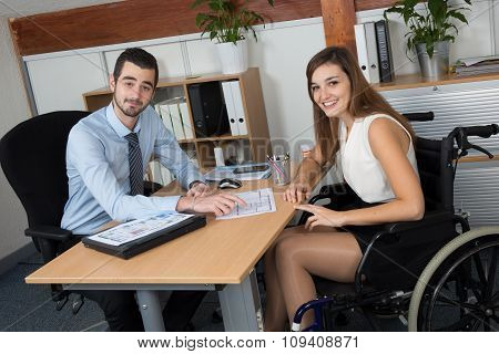 Handicapped Happy Woman Attending A Meeting In A Bright Office