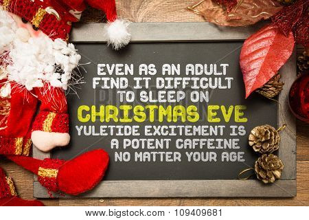 Blackboard with the text: Even As An Adult Find It Difficult To Sleep On Christmas Eve Yuletide Excitement Is a Potent Caffeine No Matter Your Age