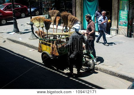 Broom stick seller on the streets of Cairo