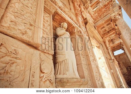 Stone Body Of Greek Goddess At Entrance Of Historical Celsus Library In Ephesus, Turkey