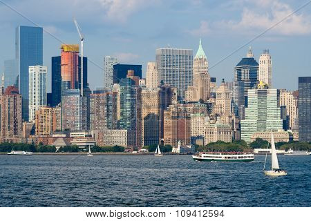 The skyline of Lower Manhattan with boats on the New York Harbor