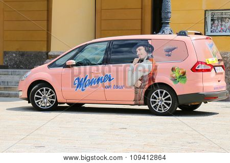 INNSBRUCK, AUSTRIA - JULY 2015 : A pink car with sticker Manner on tour  in Innsbruck, Austria on July 11, 2015. Manner is wafers manufacturer and celebrating its 125 years and conducing tours