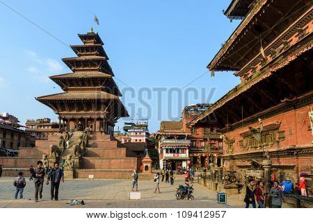 BHAKTAPUR, NEPAL - NOVEMBER 15, 2015: Taumadhi square with Nyatapola temple on the left and  Bhairavnath temple on the right.