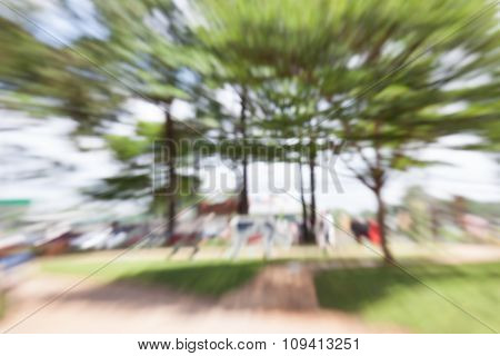 Blurred Abstract Background Of Summer Park With People Walking Around.