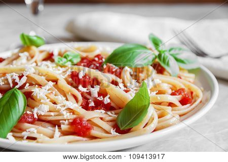 Linguine pasta in tomato sauce and cheese on a plate
