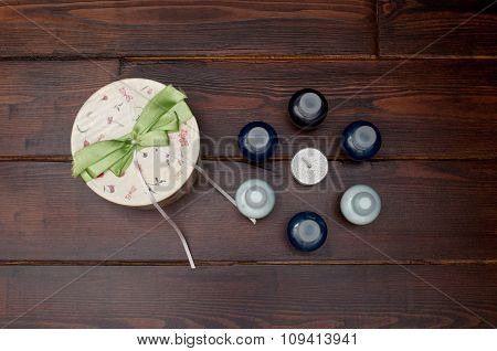 Round Gift Box With Bottles On The Table