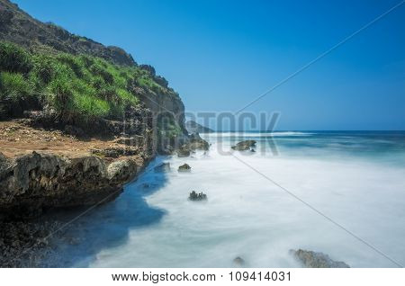 Beautiful blue sky view over seascape of Banyu Tibo Beach, Yogyakarta, Indonesia
