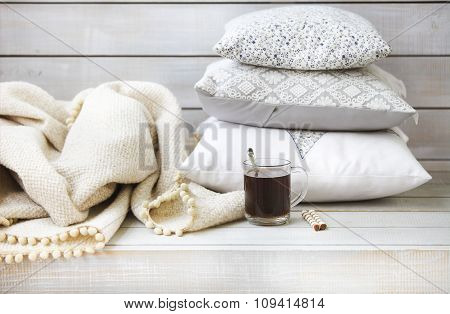 Cozy Still Life With Coffee, Pillows And Plaid