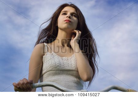 Portrait Of Pretty Girl With Retro Bicycle