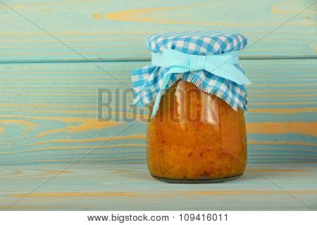 One Jar Of Quince Jam At Blue Vintage Wood Surface
