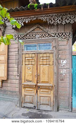 The Wooden Dilapidated Doors. Old Entrances In Irkutsk