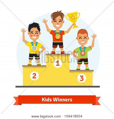 Kids sport winners standing on podium