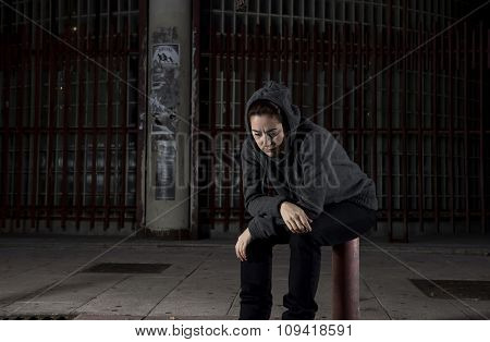 Sad Woman Alone On Street Suffering Depression Desperate And Helpless Wearing Hoodie