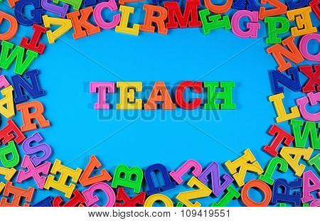 Teach Written By Plastic Colorful Letters