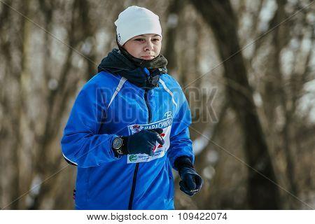 young girl participant of marathon runs across a distance closeup