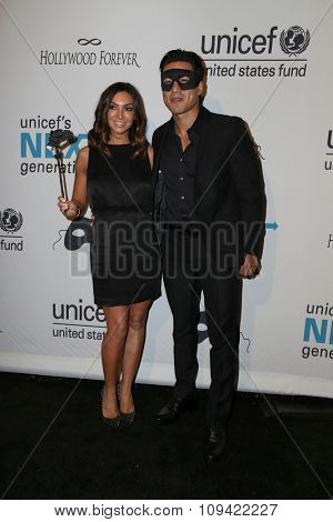 LOS ANGELES - OCT 30:  Courtney Mazza Lopez, Mario Lopez at the 2nd Annual UNICEF Masquerade Ball at the Hollywood Forever on October 30, 2014 in Los Angeles, CA