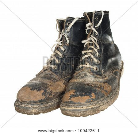 The Old Worn Out Boots With White Laces Isolated On White Background.