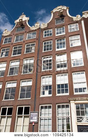 AMSTERDAMNETHERLANDS-APRIL 27: Facade of tipical Amsterdam architecture and appartments on April 27 2015 in Amsterdam Netherlands.