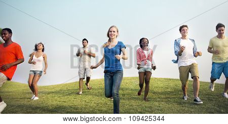 Group Casual People Running Outdoors Concept