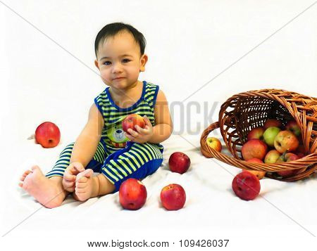Baby boy sits with a basket of apples