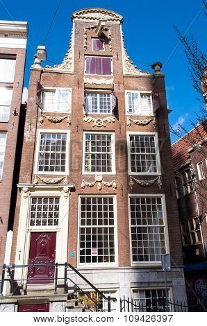 AMSTERDAMNETHERLANDS-APRIL 27: Amsterdam 17th century architecture in down town on April 27 2015 in Amsterdam Netherlands.