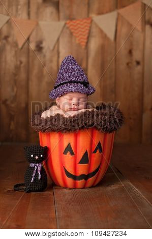 Sleeping Newborn Baby Girl Wearing A Witch Costume