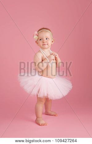 One Year Old Girl Wearing A Pink Tutu