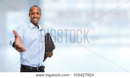 African-American businessman handshake over blue office background