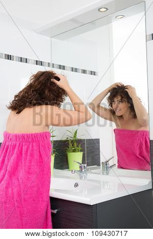 Woman Worried By Hair Getting Grey And Looking At The Hair