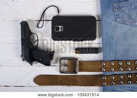 Planks, Phone, Gun, Blue Jeans And Belt