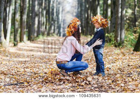 Family In Autumn Park.