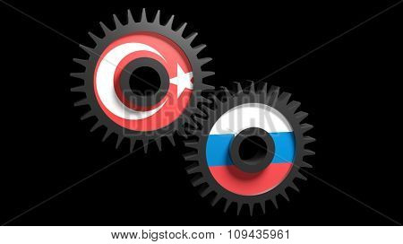Two gear wheels with Turkish and Russian flags on black background.Collaboration of Turley and Russia. Concept. Isolated.