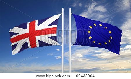 EU and British flags against of blue sky