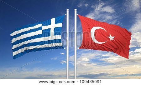 Greek and Turkish flags against of blue sky