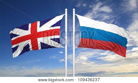 British and Russian flags against of blue sky