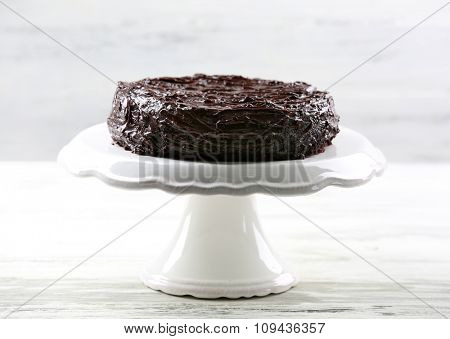 Chocolate cake on white wooden table