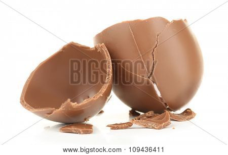 Broken chocolate Easter egg, isolated on white