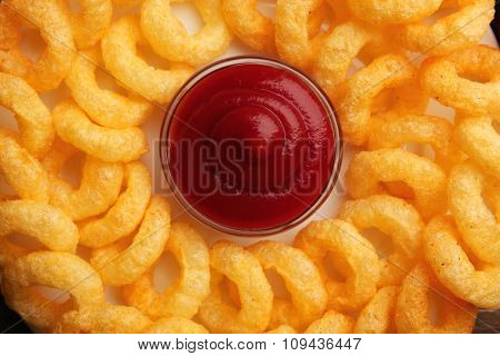 Chips rings with sauce background