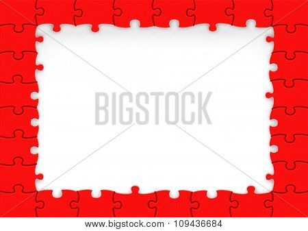 Frame made of red puzzle pieces with copy-space.