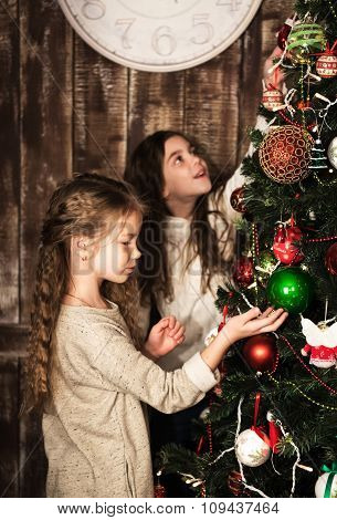 Happy Girls Decorating Christmas Tree